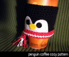 Penguin Coffee Cozy by AuntJanet | Crocheting Pattern - Looking for a crocheting pattern for your next project? Look no further than Penguin Coffee Cozy from AuntJanet! - via @Craftsy