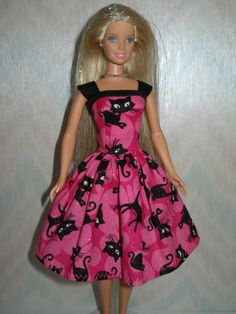 Handmade Barbie clothes - Pink and black cat dress. $7.00, via Etsy.