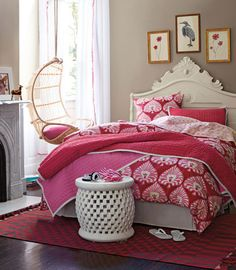 Serena & Lily red and pink bedding. Love that hanging chair too!