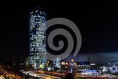 A skyscraper situated in the business district of bucharest. The picture is a long exposure shot at night from the Pipera overpass. The building is currently the tallest in Bucharest, at 137 m