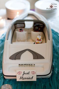 "Previous caption, ""Grooms cake - my boat would say 'Sattimo'."""