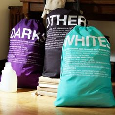 laundry bags for darks, whites, and delicates. each one has instructions on how to wash each kind