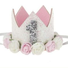 This dazzling crown was made for your birthday princess! Sparkling white glitter embellishes the crown, with dainty flowers surround the base of the crown! Add this crown to her outfit for your princess's birthday and add a little extra glam to her special day! @rufflesandbowtiebowtique #firstbirthday #birthdaycrown #sparklecrown #Flowercrown #babybirthdaycrown