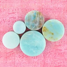 Amazonite is a green to blue-green variety of Microcline, a Feldspar mineral that forms in short prismatic or tabular crystals or in masses. It ranges in hue from bright green to paler shades of turqu