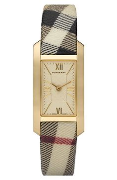 Free shipping and returns on Burberry Ladies' Gold Case Check Strap Watch at Nordstrom.com. Elegant Roman numerals mark a rectangular dial that's overlaid with scratch-resistant mineral crystal and encased in brilliant gold plating. A check-print fabric strap completes the sophisticated style.