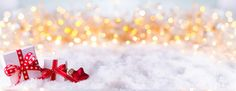 Christmas background with gift boxes in snow landscape