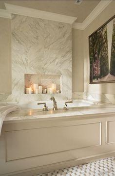 Bathroom Tub LOOKS LIKE A FIREPLACE-ADDS INTEREST.