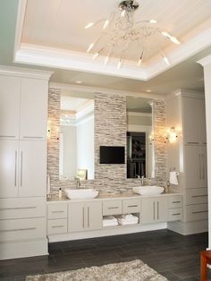 I like the two cabinets with sinks in the middle and the long Mirror.
