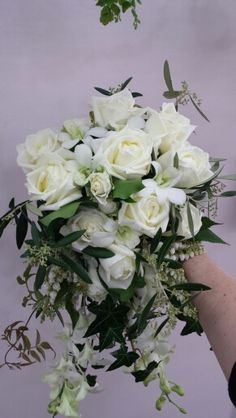 Teardrop style roses and orchids