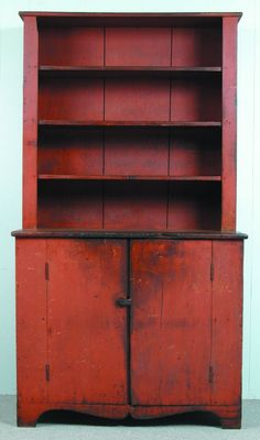"Good Ohio or PA Early 19th Century Softwood Red Painted Stepback Cupboard, one part with three shelves over cabinet top, two door base with one fixed shelf and one upper small removable shelf, arched and shaped base with bracket feet, Ex. Ron Koehler, 79""h. x43-½""w. x 21-¼""d., (minor losses to wood, front right foot restored, natural wear to original paint)."