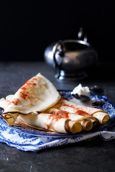 crepes with goat cheese filling palacinke sa mladim sirom /10-11 ounces white flour 2 eggs 1 teaspoon baking soda ½ teaspoon salt 2 cups milk 1 cup water 1 cup oil 8-10 ounces goat cheese Paprika (optional)