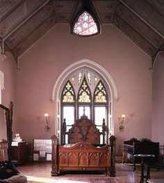 Breathtaking bedroom at Lyndhurst, Tarrytown NY.  Gothic bedstead is fantastic and rest of detail in the room, esp windows, is stunning.  Wall color of a dusty pinkish-brown is wonderful.