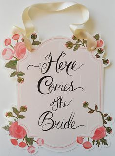 From one of our favorite Etsy designers First Snow Fall - Here Comes the Bride Sign http://www.etsy.com/listing/122988001/here-comes-the-bride-sign