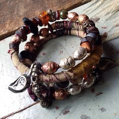 Rustic tribal wrap bracelet with recycled sari silk, Ethiopian prayer beads, tektite, amber and kuchi by quisnam on Etsy