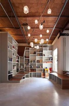 This large apartment located in Barcelona, Spain gets a massive renovation that incorporates the original building details along with modern conveniences. Led by architect Victor Gonzalez Marti of TC-Interiors, the Communicating Vessels project called for an open layout with tons of natural light and the result is a bright industrial space with loft-like appeal. by Liz Cc'