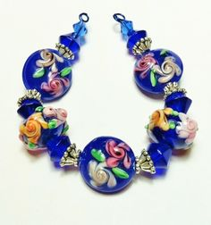 * Cobalt Blue Garden Handmade Lampwork Glass Bead Set. Starting at $5 on Tophatter.com!