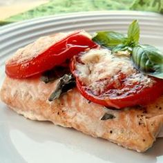 Tomato Basil Salmon-quick and simple. Sprinkle with garlic powder and pepper as well and serve with spinach for a healthy dinner! Full of protein!!