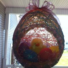 Balloon,String, liquid Starch=Easter  Egg Decoration:)...wrap balloon with Starch soaked string, let dry a few days. Pop balloon and u have and egg:)
