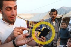 """Solar start-up helps power refugee camps in Syria.""""WakaWaka has recently launched a 'buy one, give one' campaign whereby they are donating one pocket-sized solar phone charger and light to Syrian refugees for every unit they sell...Over 25,000 WakaWaka Powers have already been provided. This enables more than an estimated 100,000 refugees to safely see, study, move about, cook, read and gather after darkness, without the risk of tent fires""""  (picture credit: Omar Alkhani)"""
