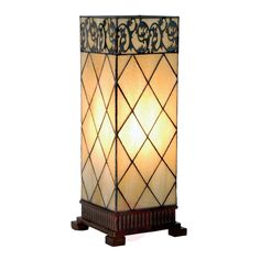 The cream-coloured glass lampshade of Tiffany table lamp Diamond sits on a square base with beautiful feet and is decorated with diamonds and a delicate pattern made of polyresin