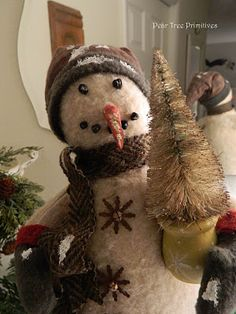 """""""In the meadow we can build a snowman,   Then pretend that he is Parson Brown  He'll say: Are you married?  We'll say: No man, But you can do the job when you're in town."""" (Winter Wonderland lyrics)  by Pear Tree Primitives"""
