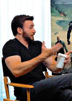 Chris Evans talking with his hands.  He's so adorable... and those fucking arms.  Guh!