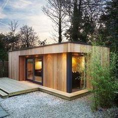 This wooden 'eco' garden room from Westbury Garden Rooms is a great contemporary option for those in an urban area, or with a more modern house. The cedar-clad room is free-standing with a grass roof, and best of all is unlikely to need planning permission. Insulated and equipped with both heating and lighting. #urbanecohouse #contemporarygardens #woodenecohouse