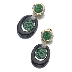 PAIR OF ONYX, JADE AND DIAMOND PENDENT EAR CLIPS, DAVID WEBB Each set to the surmount with a carved jade circular plaque framed by hammered gold and brilliant-cut diamonds, suspending an onyx drop and a swing jade centre, mounted in yellow gold and platinum