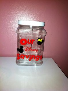 """Disney savings jar [2012-06: we now have a """"Disney Dollars"""" jar and it's already got some dollars waiting to be spent in Florida!]"""