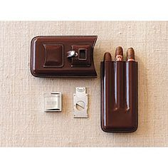@Overstock.com.com - Weston Leather Cigar Case - Cigar connoisseurs will truly appreciate this stylish leather cigar case. In addition to protecting your fine cigars, this case conveniently houses both a lighter and cutter. Offered in a rich brown color, this case is a great accessory to any wardrobe.  http://www.overstock.com/Gifts-Flowers/Weston-Leather-Cigar-Case/4409438/product.html?CID=214117 $79.99