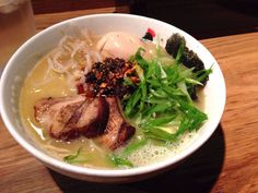 Ramen is one of Japan's most well-known dishes — thin, curly noodles served in fatty chicken or pork broth. Sliced scallions, chashu (pork), and a soft boiled egg are common toppings.
