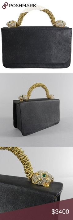 """Vintage 1969 Kenneth J Lane for Rosenfeld Jewelled Vintage 1969 Kenneth J. Lane for Rosenfeld hand bag. Gold beaded handle with rhinestone jeweled panther heads. Black sharkskin textured body with black satin interior lining. Snap closure and includes original pocket mirror. Body measures 7.5 x 4.75 x 4"""". Kenneth Jay Lane Bags Totes"""