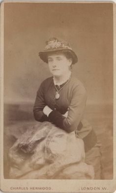 CDV photo taken in Turnham Green, London around 1880s by Charles Henwood (born 1843). Henwood also operated a studio in Chiswick. This great photo shows a victorian girl from London wearing an exquisite dress and hat, with a pendant around her neck.