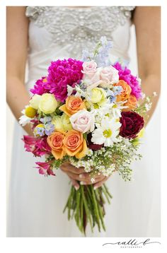 Hand held natural stem bouquet with peonies, Easter daisy and billy buttons