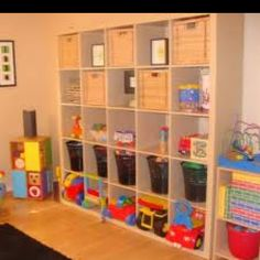 Toy room storage: I need an entire wall like this!!