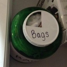 I made the bag holder out of a protein container. Pinned in my Kitchen Organization.