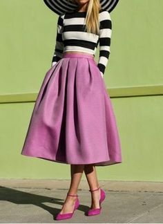Black-and-white striped shirt with a pink midi skirt