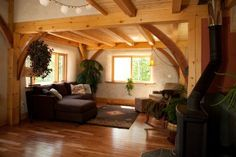 Straw Bale Homes | This timber frame home has walls of straw bales with earthen plaster ...