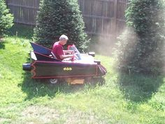 a batmobile lawn mower... that's what i'm talkin about. :)