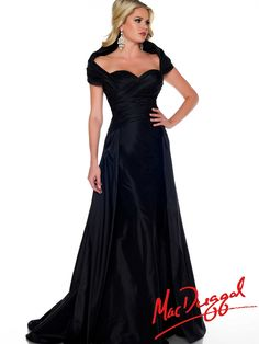 This Mac Duggal pageant dress is sure to be a pageant gown that will have you getting noticed. This black silk taffeta Mac Duggal 43095P pageant dress has an off the shoulder puff design, gorgeous sweetheart ruched bodice, and a floor length skirt with a full overlay skirt with a train. If you are gorgeous and you know it, slip into this stylish Mac Duggal pageant dress.