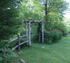 rustic garden fence and arbor