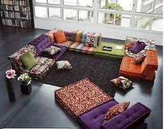floor pillow seating | First I love the fact that it is floor seating and yet still feels ...