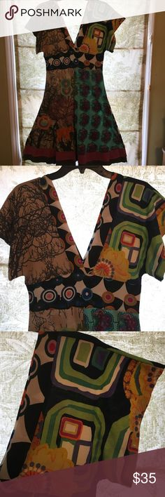 Desigual brand jersey knit multi printed dress Desigual printed Jersey knit dress has deep v neckline ( should wear camisole under). Multi patch work prints with ethnic patterns front and back. Drop shoulder sleeve. Fitted at midriff and Flares out. Size medium Desigual Dresses Midi