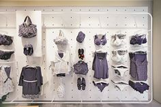 Vitra's Mono 20 is used to display apparel. This shows the flexibility in the product. A wall can be changed to suit the product. Retail, Display, Suits, Flexibility, Wall, Home Decor, Floor Space, Decoration Home, Billboard
