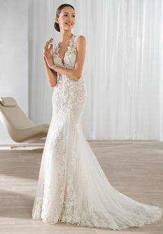 V-neck mermaid dress with lace embellishment | Demetrios Style 595 | http://knot.ly/6490Btmii