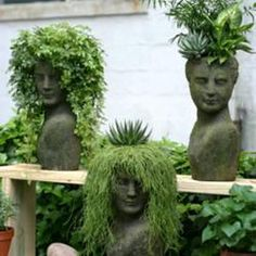 Created a variety of beautiful female head planters with various unusual plants. Gals are named Princess, Showgirl and Queen of the Forest! Have fun!