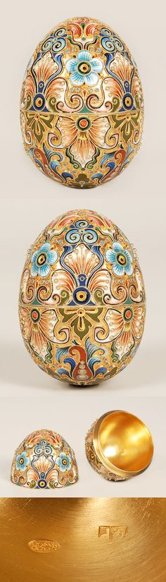 A Russian gilded silver and shaded cloisonne enamel egg by Feodor Ruckert, Moscow, circa 1896-1908. Decorated with shaded cloisonne enamel flowers and scrolling folaige