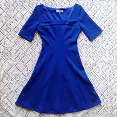 Madison Leigh Flared Dress Madison Leigh royal blue flared dress. Elbow length sleeves. Fabric is extremely stretchy. Textured fabric. Easy to pack and wear. Runs small. Comparable to 4-6 Madison Leigh  Dresses