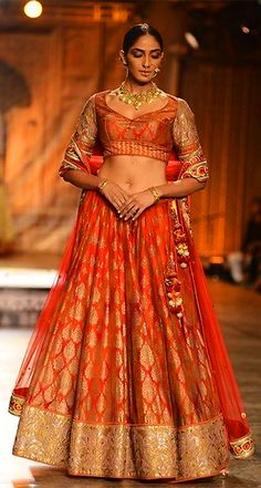 A model displays a beautiful designer bridal lehenga at one of the FDCI ICW events. (Image Source: Pinterest)