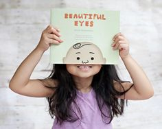 """""""Beautiful Eyes"""" (Meritage Press, 2012), a bilingual Tagalog/English book by Gayle Romasanta, Ramon Abad and translators Carmen and Pat Romasanta   Photo by Gena Roma"""